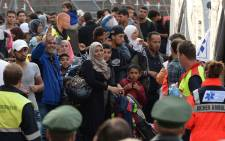Incoming refugees wait for a medical check after their arrival in front of the main train station in Munich, Germany in September 2015. Picture: AFP