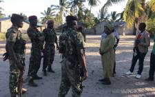 Mozambican Army personnel talks with Nuance Mayor, Joaquina Nordine (3rdR), in Naunde, northern Mozambique, on 13 June, 2018. Picture: AFP