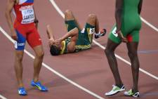 """South Africa's Wayde Van Niekerk reacts after winning the final of the men's 400 metres athletics event at the 2015 IAAF World Championships at the """"Bird's Nest"""" National Stadium in Beijing on 26 August, 2015. Picture: AFP"""
