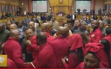 FILE: EFF MPs are thrown out during Pravin Gordhan's Public Enterprises budget vote. Picture: Parliament YouTube.
