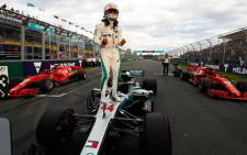 Formula One champion Lewis Hamilton celebrates pole position at the season-opening Australian Grand Prix. Picture: @ausgrandprix/Twitter