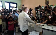 Greek Finance Minister Yanis Varoufakis casts his ballot during the Greek referendum in Athens, on 5 July, 2015. Greece voted in a tightly fought referendum that Prime Minister Alexis Tsipras said will determine its destiny in the eurozone, as the EU country teetered on the brink of financial collapse. Picture: AFP.