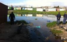 Police assess flood damage in Khayelitsha, Cape Town after heavy rains. Picture: Rahima Essop/EWN
