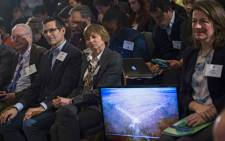 A picture of the LIGO Detector is shown as members of the news media and guests listen to remarks on the discovery of gravitational waves during a press conference in Washington, DC, USA, 11 February 2016. US researchers say they have detected gravitational waves, which physicist Albert Einstein first described 100 years ago as 'ripples in the fabric of space-time.' Scientists from Caltech and the Massachusetts Institute of Technology (MIT) made the announcement in Washington and other locations around the world. The signal detected with LIGO, an observatory with sites on both sides of the United States, was very clear and there was no room for doubt that it was direct evidence of the waves, said Bruce Allen, who is acting director at Germany's Max Planck Institute for Gravitational Physics. Picture: EPA/SHAWN THEW