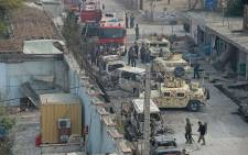 Afghan security personnel gather near an office of the British charity Save the Children after an attack in Jalalabad on 24 January 2018. Picture: AFP