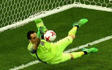 Chile goalkeeper Claudio Bravo saves a penalty. Picture: @FIFAcom/Twitter