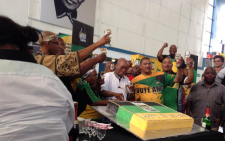 Jacob Zuma cutting the birthday cake with bubbly in hand. Picture: Rahima Essop/EWN