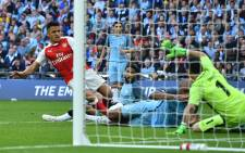 Arsenal forward Alexis Sanchez shoots past Manchester City's goalkeeper Claudio Bravo to score the second goal during the FA Cup semi-final football match between Arsenal and Manchester City at Wembley Stadium in London on 23 April, 2017. Picture: AFP