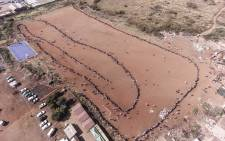Aerial view of the queue of residents of Iterileng informal settlement waiting to receive their food parcels on 20 May 2020.