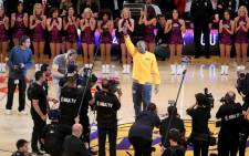 Kobe Bryant is applauded before his final game. Picture: AFP.