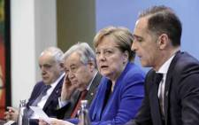 (LtoR) Special Representative and Head of the United Nations Support Mission in Libya Ghassan Salame; Secretary-General of the United Nations Antonio Guterres; German Chancellor Angela Merkel and German Foreign Minister Heiko Maas give a press conference at the end of a Peace summit on Libya at the Chancellery in Berlin on 19 January 2020. Picture: AFP.