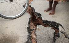 FILE: The pavement is split in the village of Rutunga in the province of Bururi, 35 km south of the capital Bujumbura, after flooding near the Rutunga river. Landslides in Burundi have killed several people following heavy rain. Picture: AFP