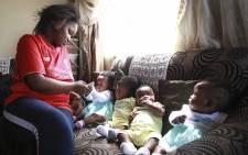 First time mom, Inga Mafenuka and her quadruplets Bubele, Buchule, Bunono and Bungcwele. Picture: Cindy Archillies/EWN