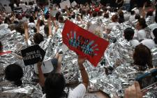 Protesters that marched from Freedom Plaza to the US Capitol demonstrate inside the Hart Senate Office Building against family detentions and to demand the end of criminalizing efforts of asylum seekers and immigrants 28 June 2018 in Washington. Picture: AFP