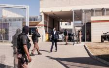 Officials are seen at the Estcourt Correctional Centre, where former South African President Jacob Zuma began serving his 15-month sentence for contempt of the Constitutional Court, in Estcourt, on 8 July 2021. Picture: AFP