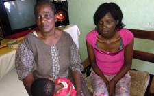 The family of the young girl who was raped and set alight. Carmel Loggenberg/EWN.