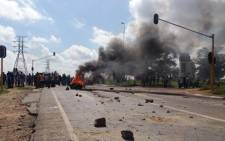 Police arrested 20 demonstrators in Durban Deep after a violent protest over housing this morning. Picture: Lesego Ngobeni/EWN.