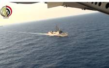 An image grab taken from a handout video released by the Egyptian Defence Ministry on 20 May 2016 shows the Egyptian military taking part in a search mission in the Mediterranean Sea for the remains of an EgyptAir plane which crashed on 19 May 2016 with 66 people on board. Picture: Egyptian Defence Ministry/AFP.