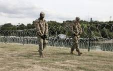 Soldiers from the Kentucky-based 19th Engineer Battalion work in a public park in Laredo, Texas, where they are installing barbed and concertina-wire on 17 November, 2018. Picture: AFP