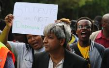 FILE: Wits University vice chancellor Adam Habib walks with students during protests on campus over proposed tuition fee increases on 16 October 2015. Picture: Reinart Toerien/EWN.