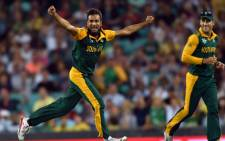 Proteas bowler Imran Taahir celebrates after grabbing a wicket. Picture: AFP.