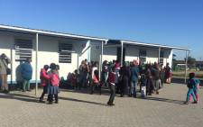 FILE: Western Cape Education and Dunoon residents, whose children have not been placed in schools in the area, at the school to resolve the matter on 21 July 2015. Picture: Masa Kekana/EWN.