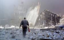 A man walks amongst the rubble at the site of the World Trade Centre shortly after the 9/11 attack. Picture: AFP.