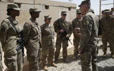 The US commander in Afghanistan John Nicholson (R) talks with soldiers in the Afghan province of Helmand on 29 April 2017. Picture: AFP