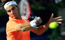 FILE: Roger Federer of Switzerland returns the ball to World number one Novak Djokovic of Serbia during their final match on the fifth day of the ATP Dubai Duty Free Tennis Championships on 28 February, 2015 in Dubai. Picture: AFP