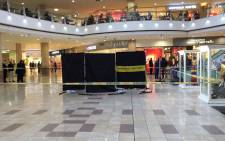 Brooklyn Mall police investigating robbery at the Scoin Shop. Curtained area is where victim lay wounded. Picture: Barry Bateman/ EWN.