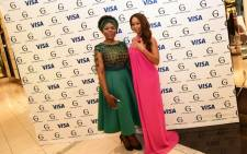 Public Protector Thuli Madonsela and TV personality Minnie Dlamini, both dressed by Gert-Johan Coetzee, at SA Fashion Week on Tuesday 5 April. Picture: Hannes Danzfuss