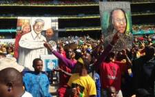 ANC supporters hold up paintings of Nelson Mandela and Jacob Zuma at the ruling party's Siyanqoba rally at the FNB Stadium in Johannesburg, 4 May 2014. Picture: Vumani Mkhize/Twitter.