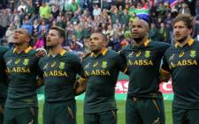 The Springboks sing the national anthem before the start of their clash against the World XV at Newlands on 7 June 2014.