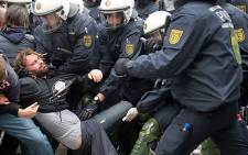 A protestor from the Blockupy movement is taken away by policemen in Frankfurt, Germany, during a an anti-austerity demonstration. Picture: AFP