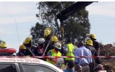 Emergency services attempt to rescue trapped miners at an illegal mine shaft in Benoni on 16 February. Picture: Reinart Toerien.