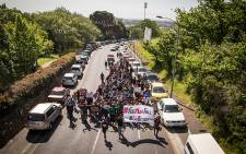 UCT students and workers march outside of the university in protest to reduce the tuition fee increase and the outsourcing of labour at UCT. Picture: Thomas Holder/EWN.