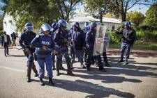 Police regroup after dispersing students. Picture: Thomas Holder/EWN.