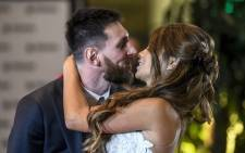 Argentine football star Lionel Messi and bride Antonella Roccuzzo pose for photographers during their wedding at the City Centre Complex in Rosario, Santa Fe province, Argentina on 30 June 2017. Picture: AFP.