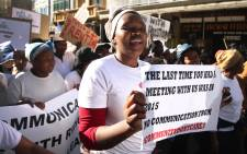 Scores of residents who live in units owned by a social rental housing company marched through the CBD to the Western Cape legislature. Picture: Bertram Malgas