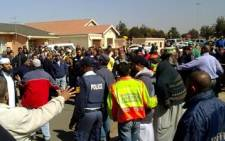 Angry Lenasia residents hurl insults at cops for not combatting crime. Picture: Ismail Mohammed/iWitness