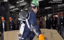 While people may worry about robots taking jobs, companies around the world are investing in wearable exoskeletons designed to help with heavy-lifting or rehabilitation. Picture: CNN