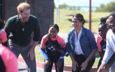 The Duke and Duchess of Sussex, Prince Harry and Meghan Markle heading to the beach for a dance and meditation session with young surfers. Picture: Bertram Malgas