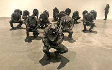 Seventeen cowering figures made of mixed media greet museum-goers at the New York museum as part of a Marikana massacre-inspired exhibit by South African artist Haroon Gunn-Salie. Picture: Nadia Neophytou/EWN