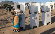 A woman casts her vote at the Ndirande Community ground polling centre on 21 May 2019 in Blantyre, southern Malawi, during the country general elections. Picture: AFP