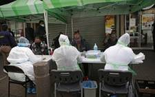 FILE: City of Tshwane Health officials conduct screening exercises on people before some of them will be tested for the COVID-19 coronavirus at the Bloed Street Mall in Pretoria Central Business District. Picture: AFP