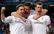 Real Madrid's Gareth Bale celebrate his goal with teammates against Borussia Dortmund in the Champions League quarter-final first leg on 2 April 2014. Picture: Facebook.