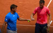 American Ryan Harrison and New Zealander Michael Venus celebrate their first grand slam Title. Picture: Twitter/@rolandgarros.