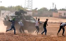 Turkish Gendarmerie clash with Kurdish demonstrators during a protest against Islamic State (IS) militants near Sanliurfa, Turkey, 07 October 2014. Picture: EPA/SEDAT SUNA.