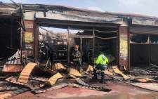 Firefighters inspect the damage caused by a fire in Kritzinger Road in Brakpan on 12 February 2021. Picture: EWN