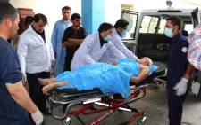 Afghan volunteers carry an injured youth on a stretcher to a hospital following a suicide attack in Kabul on 15 August 2018. Picture: AFP.